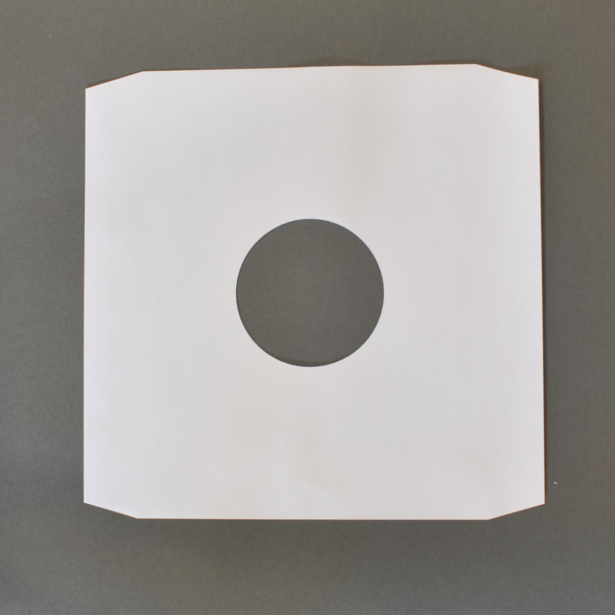 12 White Paper Sleeve Pack Of 100